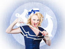 Tough pin-up sailor breaking rope. Navy seal Royalty Free Stock Photography