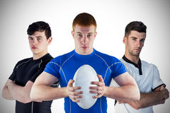 Tough rugby players standing together Stock Photo