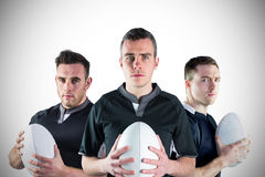 Tough rugby players standing together Royalty Free Stock Photography
