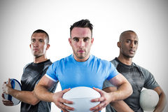 Tough rugby players standing together Royalty Free Stock Photos