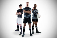 Tough rugby players standing together Stock Photos