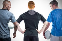 Tough rugby players standing together Stock Photography