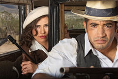 Tough 1920s Gangster Couple. Tough 1920s gangster male and female partners Stock Photos