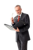 Tough senior business man with folder, isolated. Tough senior business man with folder and a pair of glasses, isolated royalty free stock photo