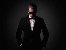 Tough sharp dressed man. In black suit Stock Photo