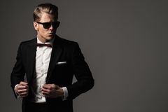 Tough sharp dressed man. In black suit Stock Photography