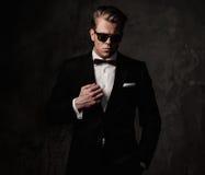 Tough sharp dressed man. In black suit Royalty Free Stock Photo