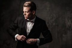Tough sharp dressed man. In black suit Royalty Free Stock Photos