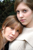 Tough times. Two girls comforting one another in difficult times stock photography