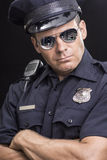 Tough uniformed street cop Royalty Free Stock Images