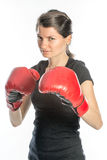 Tough woman boxing. Beautiful tough woman wearing red boxing gloves in her hands - isolated on white Stock Image