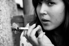 Tough woman smoking Stock Photography