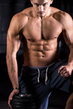 Tough young bodybuilder in gym Royalty Free Stock Photo