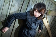 Tough young girl. In black clothes and old wooden fence Royalty Free Stock Image