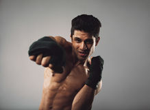 Tough young man doing some shadow boxing Stock Photography