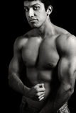 Tough young man with muscular body Stock Image