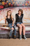 Tough Young Skateboarders. Tough pair of white female gang members Royalty Free Stock Photo