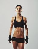 Tough young woman with muscular body royalty free stock photo