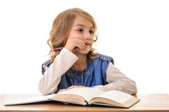 Toughtful little girl doing homework Royalty Free Stock Photos