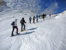 Snowshoes up. Touists with snowshoes on the mount meta in abruzzo national park in italy Stock Photo