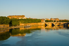 Toulouse cityscape. Toulouse (France) cityscape (sunset): Pont Neuf bridge,Garonne river,church,canal,tree and sky Royalty Free Stock Photo