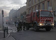 Firemen are putting out fire during demonstration of Yellow Vests stock images