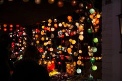 TOULOUSE, FRANCE - NOVEMBER 30, 2016, Lighting stand, lights ins. Ide colorful Christmas balls, at night, Christmas market in Toulouse, France stock image