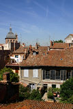 Toulouse, old houses and Saint-Pierre des Chartreux roof. Toulouse, old houses with tiles, in the city center, in the background Saint-Pierre des Chartreux Royalty Free Stock Image