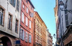 Colorful apartment buildings along Toulouse street royalty free stock image
