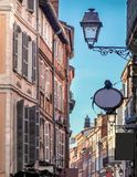 Toulouse street,with colorful old buildings. Toulouse has many ancient streets with beautiful colorful and characterful buildings,leading to squares and parks royalty free stock photo