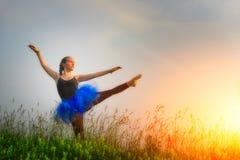 Toung beautiful ballerina dancing outdoors Stock Photography