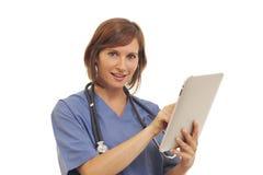 Toung Frauendoktor scheuert innen sich lizenzfreies stockfoto