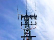 Tour électrique avec le ciel nuageux Photographie stock