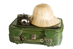 On Tour. Suitcase with safari hat and old camera - isolated on white background stock photo