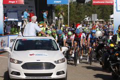 2013 Tour of Alberta. Riders follow the pace car at the start of Stage 1 of the inaugural 2013 Tour of Alberta bike race in Sherwood Park, Canada on September 4 Stock Photos