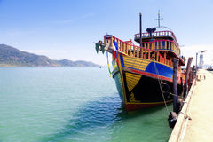 Tour boat. Traditional Thai tour boat tied at the pier on Koh Chang Island in Thailand Stock Images