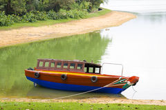 Tour Boat. Lagoon, lake, boat, red, blue, green, Singapore, tours, trip, vacation Stock Images