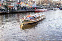 Tour boat in Amsterdam Stock Photography