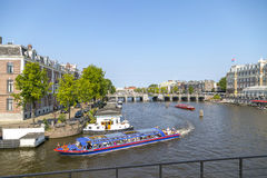 Tour Boat on Amsterdam Canal Stock Photo