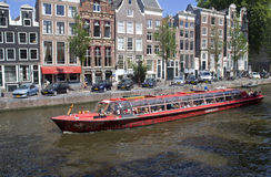Tour boat in Amsterdam Royalty Free Stock Photo