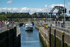 Tour boat approaching Ballard Locks. Seattle, USA July 20, 2016: Tour boat crowded with tourists enters Hiram Chittenden (Ballard) Locks. Tourist gather at locks Stock Photos
