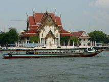 Tour Boat on the Chao Phraya River. In Bangkok, Thailand. The Chao Phraya River in Bangkok, Thailand is the bloodline of this beautiful city as it brings the stock images