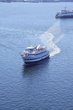 Tour boat cruises the harbor Royalty Free Stock Images