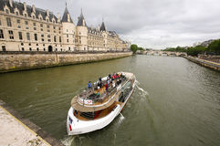 Tour boat cruising down the Seine River Royalty Free Stock Images