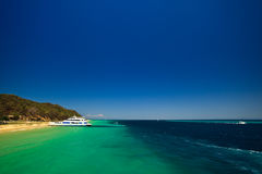 Tour boat docked at Moreton Island, Australia Royalty Free Stock Images