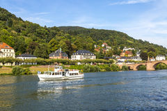 Tour Boat in Heidelberg, Germany. A tourist tour boat cruises the Neckar River in Heidelberg, German y stock photography