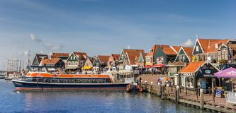 Tour boat in the historic harbor of Volendam Stock Photos