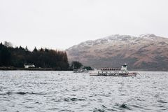Tour boat on Loch Lomond near Tarbet, Scotland, in spring. Royalty Free Stock Images