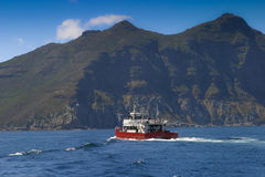 Tour boat moving. In Hout Bay South Africa Royalty Free Stock Photography
