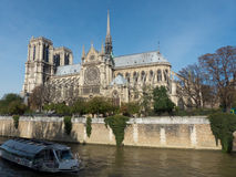 Tour boat and Notre Dame Cathedral in the city of Paris France Stock Photography